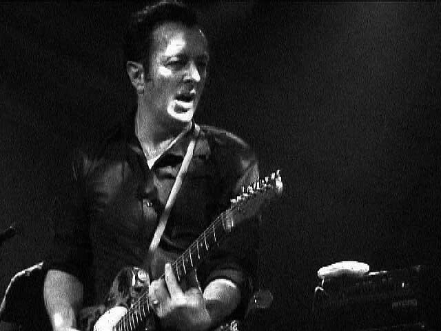1.Joe_Strummer_performing_at_St_Ann's_Warehouse,_Brooklyn_-_NYC_Apr_5_2002